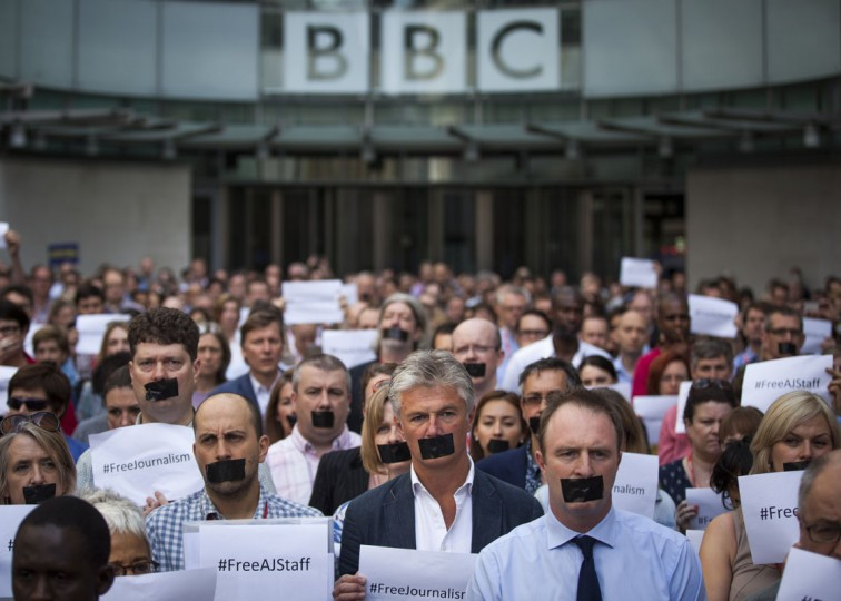 BBC staff and colleagues from other news organisations take part in a one-minute silent protest outside New Broadcasting House against the seven-year jail terms given to three al-Jazeera journalists in Egypt on June 24, 2014 in London, England. A court in Cairo found al-Jazeera's Cairo bureau chief, Mohamed Fahmy, who is Canadian-Egyptian, Egyptian producer Baher Mohamed and Australian correspondent Peter Greste guilty of spreading false news. (Getty Images/Rob Stothard)