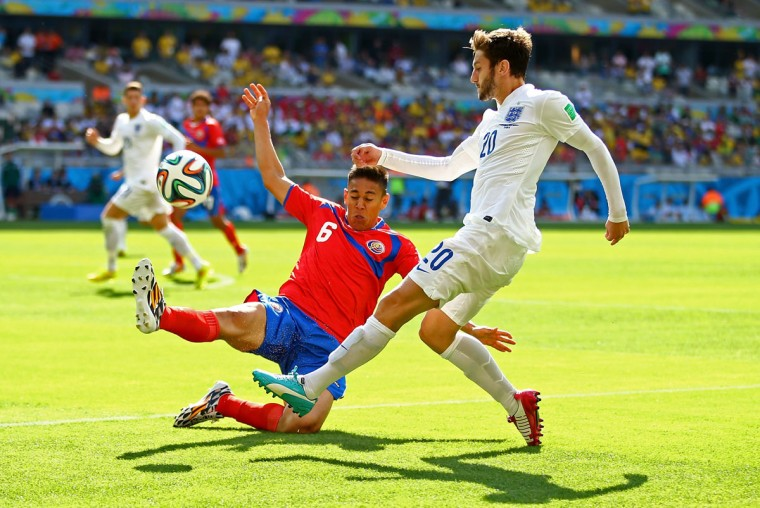 Adam Lallana of England is challenged by Oscar Duarte of Costa Rica during a 2014 FIFA World Cup Brazil Group D match at Estadio Mineirao on June 24, 2014 in Belo Horizonte, Brazil. (Photo by Richard Heathcote/Getty Images)