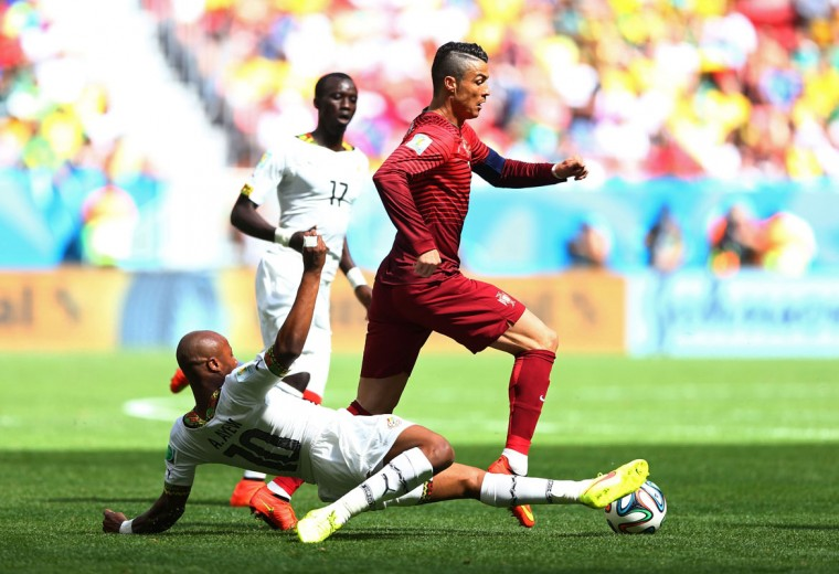Andre Ayew of Ghana tackles Cristiano Ronaldo of Portugal during the 2014 FIFA World Cup Brazil Group G match between Portugal and Ghana at Estadio Nacional on June 26, 2014 in Brasilia, Brazil. (Photo by Elsa/Getty Images)