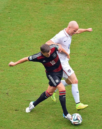 Michael Bradley of the United States challenges Toni Kroos of Germany during the 2014 FIFA World Cup Brazil group G match between the United States and Germany at Arena Pernambuco on June 26, 2014 in Recife, Brazil. (Photo by Laurence Griffiths/Getty Images)