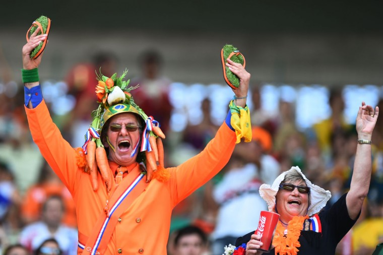 Fans of the Netherlands enjoy the atmosphere prior to the 2014 FIFA World Cup Brazil Round of 16 match between Netherlands and Mexico at Castelao on June 29, 2014 in Fortaleza, Brazil. (Laurence Griffiths/Getty Images)