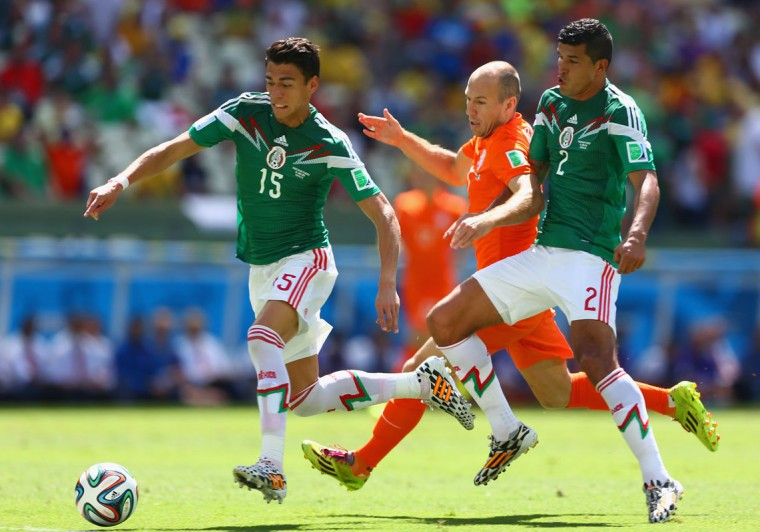 Arjen Robben of the Netherlands is challenged by Hector Moreno (L) and Francisco Javier Rodriguez of Mexico during the 2014 FIFA World Cup Brazil Round of 16 match between Netherlands and Mexico at Castelao on June 29, 2014 in Fortaleza, Brazil. (Michael Steele/Getty Images)