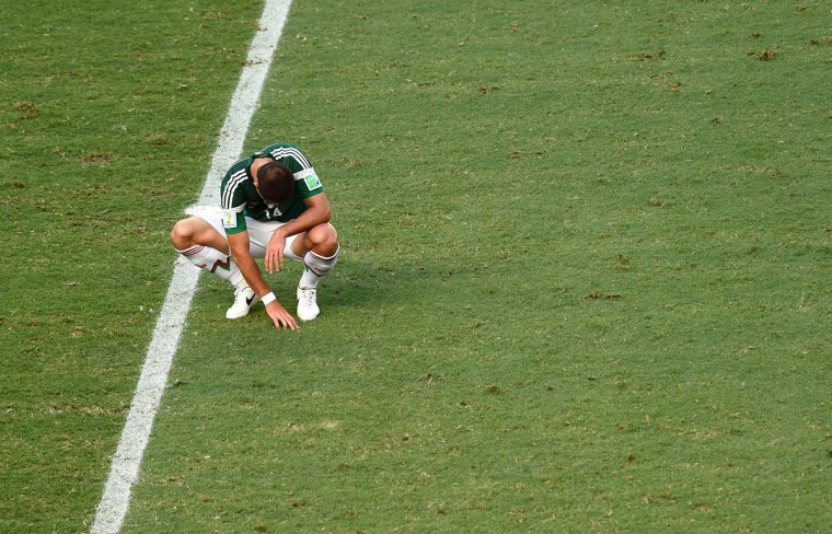 A dejected Javier Hernandez of Mexico looks on after being defeated by the Netherlands 2-1 during the 2014 FIFA World Cup Brazil Round of 16 match between Netherlands and Mexico at Castelao on June 29, 2014 in Fortaleza, Brazil. (Jamie McDonald/Getty Images)