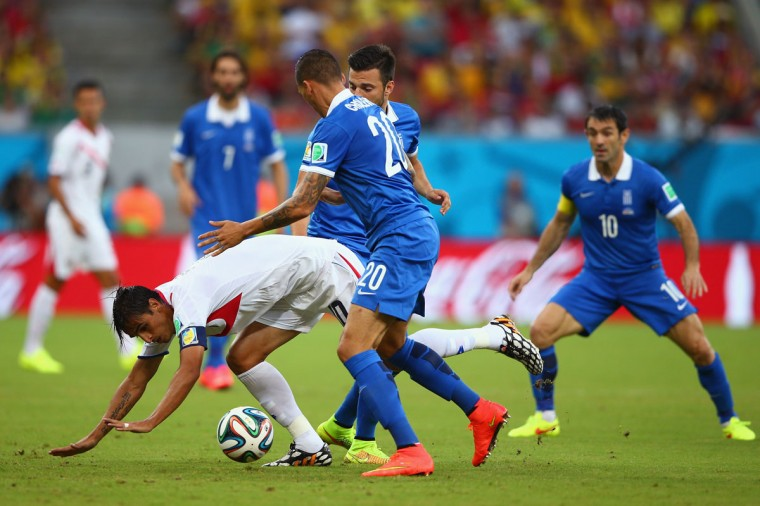 Bryan Ruiz of Costa Rica competes for the ball with Jose Cholevas of Greece during the 2014 FIFA World Cup Brazil Round of 16 match between Costa Rica and Greece at Arena Pernambuco on June 29, 2014 in Recife, Brazil. (Paul Gilham/Getty Images)
