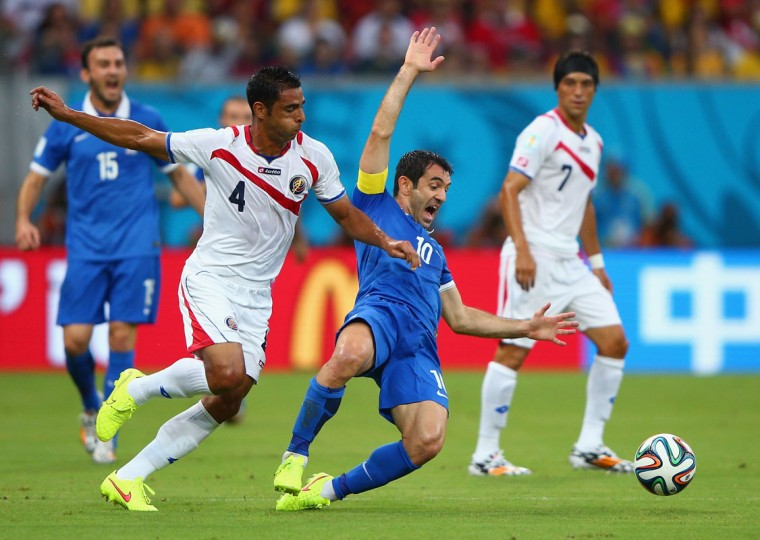 Michael Umana of Costa Rica challenges Giorgos Karagounis of Greece during the 2014 FIFA World Cup Brazil Round of 16 match between Costa Rica and Greece at Arena Pernambuco on June 29, 2014 in Recife, Brazil. (Ian Walton/Getty Images)