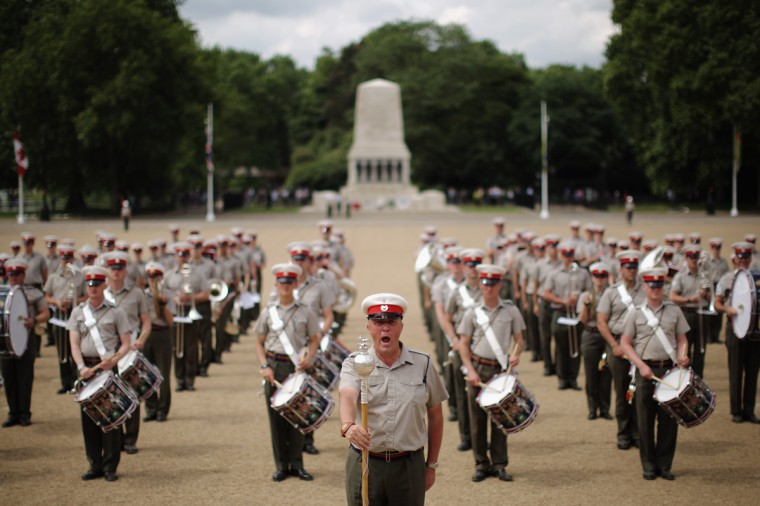 Members of the Royal Marines rehearse for the ceremonial 'Beating Retreat' event on Horse Guards Parade on June 2, 2014 in London, England. The event is part of the celebration marking the Royal Marines' 350th anniversary and this year will be the largest ever with a 490 strong parade made up of a Royal Guard from 42 Commando Royal Marines and all five Royal Marines Massed Bands, along with their colleagues from the Royal Marines Band Service Corps of Drums and Fanfare team. In addition there will be 45 ranks from the 2nd Marine Division Band, United States Marine Corps and 60 ranks from the Royal Netherland Marine Corps Band. (Dan Kitwood/Getty Images)