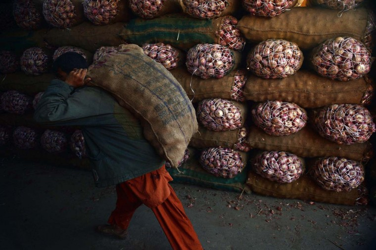 A Pakistani labourer carries a sack of onions at a  fruit and vegetable market in Islamabad on June 3. Pakistani Finance Minister Ishaq Dar will present the country's annual budget for FY 2014-2015 in the National Assembly on June 3.  || CREDIT: AAMIR QURESHI - AFP/GETTY IMAGES