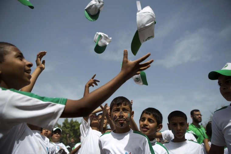 Palestinian children take part in a summer camp organized by Hamas on June 3. Thousands of elementary school students in the Gaza Strip are going to Hamas summer camps, in which they take part in recreational activities and participate in political demonstrations in solidarity with Palestinian prisoners held in Israeli jails.  || CREDIT: MOHAMMED ABED - AFP/GETTY IMAGES
