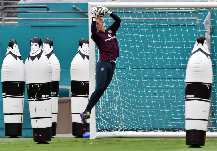 England goalkeeper Joe Hart jumps for the ball during his team's training session at Miami Sun Life Stadium in Miami Gardens, Florida on June 3.  || PHOTO CREDIT: MLADEN ANTONOV - AFP/GETTY IMAGES