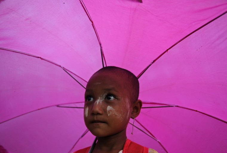 A young Myanmar elementary student holding her umbrella as she walks home in a village in the Hlegu township on the outskirts of Yangon. (Soe Than Win/AFP/Getty Images)