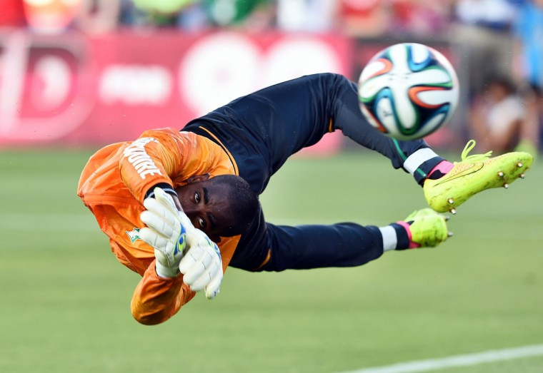 Ivory Coast's goalkeeper Boubacar Copa Barry warms up before a World Cup preparation match between Ivory Coast and El Salvador at the Toyota Stadium in Frisco, Texas, on June 4, 2014. The west Africans have been drawn in Group C along with Colombia, Greece and Japan for World Cup 2014 and kick off their campaign in Recife, Brazil, on June 14 against the Japanese. (Jewel Samad/AFP/Getty Images)