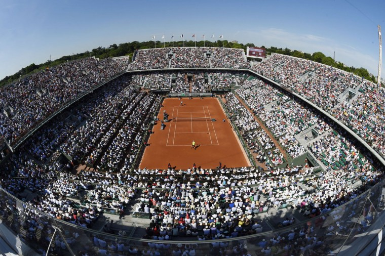 General view taken on June 6, 2014 in Paris shows Great Britain's Andy Murray (yellow jersey) playing against Spain's Rafael Nadal during their French tennis Open semi-final match at the Roland Garros stadium in Paris. (Miguel Medina/AFP/Getty Images)