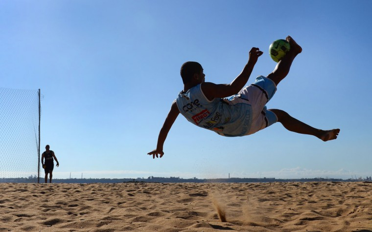 A player performs a bicycle kick as he trains with the Rio Branco Beach Soccer team in Vitoria, Brazil on June 6, 2014. Football-mad Brazil is preparing for the 2014 FIFA World Cup which starts June 12. (William West/AFP/Getty Images ORG)