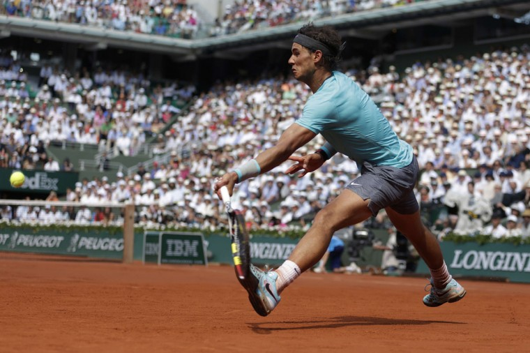Spain's Rafael Nadal hits a return to Serbia's Novak Djokovic during the French tennis Open men's final match at the Roland Garros stadium in Paris on June 8, 2014. (Kenzo Tribouillard/AFP/Getty Images)