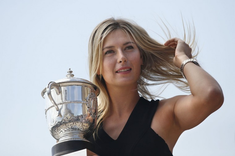 Russia's Maria Sharapova poses with the Suzanne Lenglen trophy in Paris on June 8, 2014 a day after winning the Roland Garros French Tennis Open. (Kenzo Tribouillard/AFP/Getty Images)