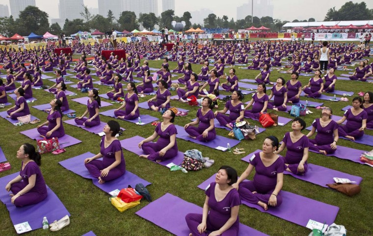 This picture taken on June 8, 2014 shows pregnant women practicing yoga as they attempt to break the Guinness World Record for the largest prenatal yoga class, in Changsha, central Hunan province. 505 pregnant women participated in a yoga class that lasted for 37 minutes and 28 seconds, exceeding the current Guinness World Record set in Shenzhen in 2013 with 423 women, local media reported. (AFP/Getty Images)