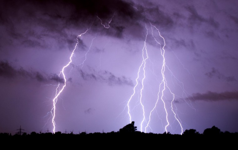 Lightning is pictured on June 10, 2014 over Algermissen, Germany. Violent storms killed at least six people in western Germany overnight, felling trees and snarling road and rail traffic, authorities said Tuesday. (Julian Stratenschulte /Germany Out/AFP/Getty Images)