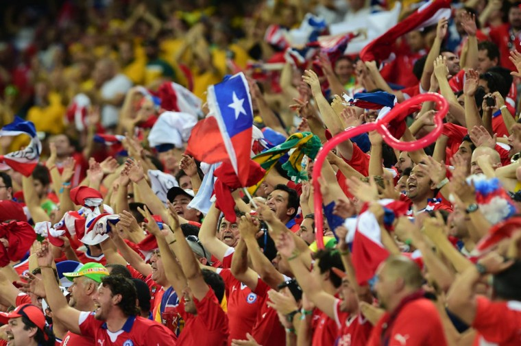 Chile's fans cheer for their team during a Group B football match between Chile and Australia at the Pantanal Arena in Cuiaba during the 2014 FIFA World Cup on June 13, 2014. (Martin Bernetti/Getty Images)