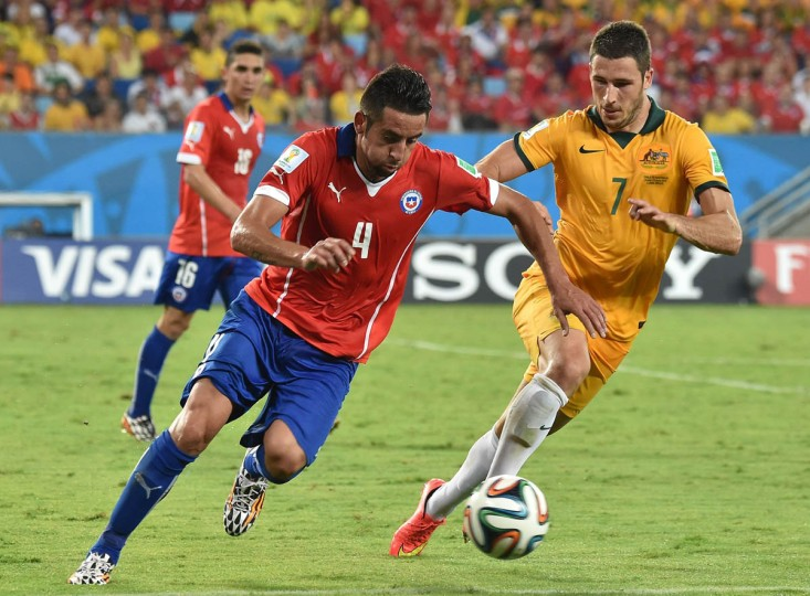 Australia's forward Mathew Leckie (Right) and Chile's defender Mauricio Isla vie for the ball during a Group B football match between Chile and Australia at the Pantanal Arena in Cuiaba during the 2014 FIFA World Cup on June 13, 2014. (Luis Acosta/Getty Images)