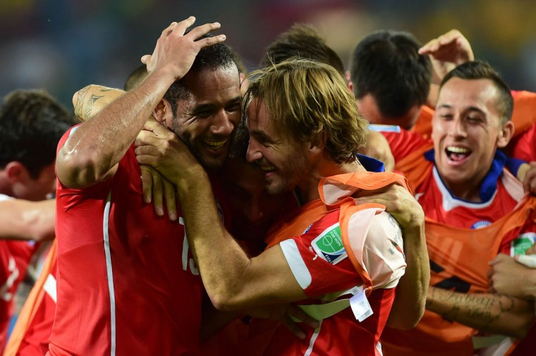Chile's midfielder Jean Beausejour (Front Left) celebrates after scoring his team's third goal during a Group B football match between Chile and Australia at the Pantanal Arena in Cuiaba during the 2014 FIFA World Cup on June 13, 2014. (Martin Bernetti/Getty Images)