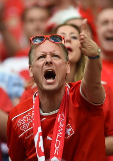 A Swiss fan reacts during a Group E football match between Switzerland and Ecuador at the Mane Garrincha National Stadium in Brasilia during the 2014 FIFA World Cup on June 15, 2014. (Pedro Ugarte/AFP/Getty Images)