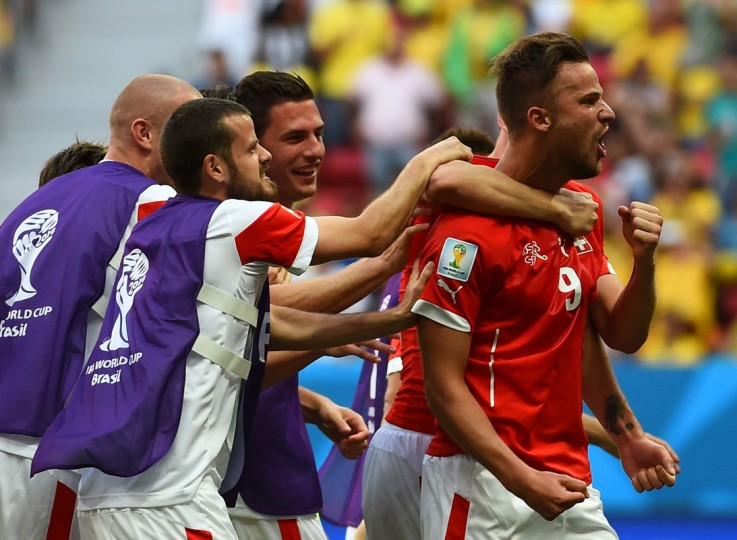 Switzerland's forward Haris Seferovic (R) celebrates after scoring during a Group E football match between Switzerland and Ecuador at the Mane Garrincha National Stadium in Brasilia during the 2014 FIFA World Cup on June 15, 2014. Switzerland won 2-1. (Anne-Christine Poujoulatanne/AFP/Getty Images)