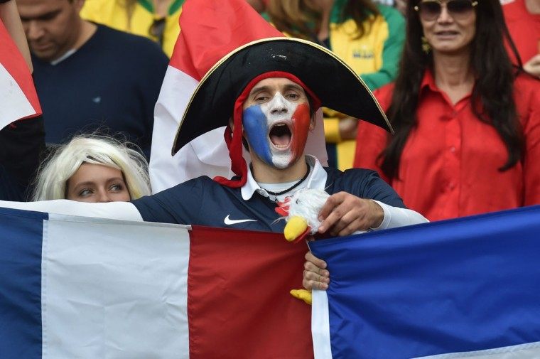 A French fan cheers during a Group E football match between France and Honduras at the Beira-Rio Stadium in Porto Alegre during the 2014 FIFA World Cup on June 15, 2014. (Rodrigo/Arangua/AFP/Getty Images)