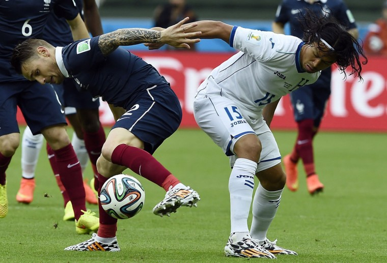 France's defender Mathieu Debuchy (L) challenges Honduras' midfielder Roger Espinoza for the ball during the Group E football match between France and Honduras at the Beira-Rio Stadium in Porto Alegre on June 15, 2014, during the 2014 FIFA World Cup. (Franck Fife/AFP/Getty Images)