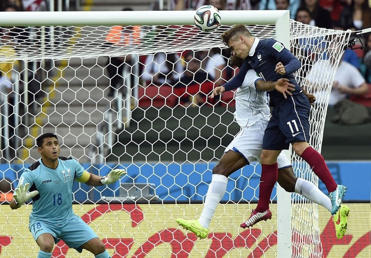 France's forward Antoine Griezmann (R) challenges Honduras' defender Maynor Figueroa (C) for the ball as goalkeeper and captain Noel Valladares (L) looks on during the Group E football match between France and Honduras at the Beira-Rio Stadium in Porto Alegre on June 15, 2014, during the 2014 FIFA World Cup. (Franck Fife/AFP Getty Images)A