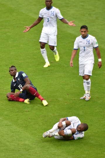 Honduras' midfielder Wilson Palacios (R) and France's midfielder Paul Pogba fall after a tackle during a Group E football match between France and Honduras at the Beira-Rio Stadium in Porto Alegre during the 2014 FIFA World Cup on June 15, 2014. Luis Acostalui/AFP/Getty Images)