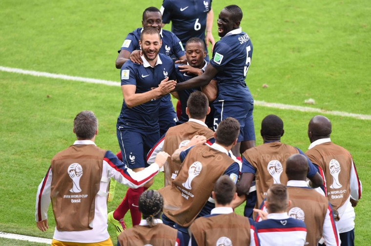 France's footballers celebrate after an own goal during a Group E football match between France and Honduras at the Beira-Rio Stadium in Porto Alegre during the 2014 FIFA World Cup on June 15, 2014. (Luis Acostaluis/AFP/Getty Images)