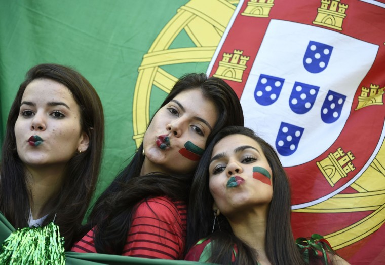 Portugal fans pose prior to the Group G football match between Germany and Portugal at the Fonte Nova Arena in Salvador during the 2014 FIFA World Cup on June 16, 2014. (ODD ANDERSEN/AFP/Getty Images)