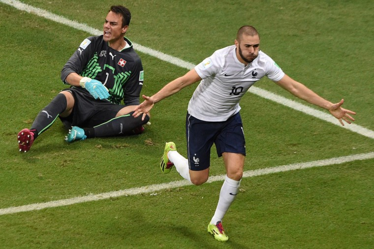 France's forward Karim Benzema celebrates after scoring during a Group E football match between Switzerland and France at the Fonte Nova Arena in Salvador during the 2014 FIFA World Cup on June 20, 2014. (Dimitar Dolkoff/AFP/Getty Images)