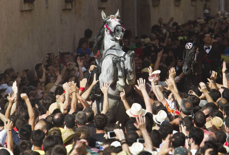 A horse rears in the crowd during the annual San Juan's festival in Ciutadella, on the Balearic Island of Menorca, marking the eve of Saint John's day. (Jaime Reina/Getty Images)