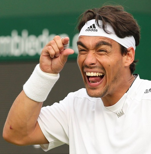 Italy's Fabio Fognini gestures as he reacts to a decision during a game against US player Alex Kuznetsov during their men's singles first round match on day one of the 2014 Wimbledon Championships at The All England Tennis Club in Wimbledon, southwest London. (Andrew Yates/Getty Images)
