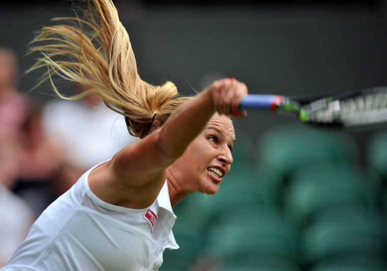 Slovakia's Dominika Cibulkova serves to Canada's Aleksandra Wozniak during their women's singles first round match on day one of the 2014 Wimbledon Championships at The All England Tennis Club in Wimbledon. (Glyn Kirk/Getty Images)