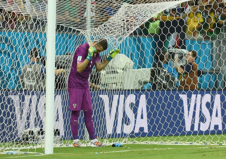 Croatia goalkeeper Stipe Pletikosa reacts after Mexico scored during a Group A football match between Croatia and Mexico at the Pernambuco Arena in Recife during the 2014 FIFA World Cup on June 23, 2014. (EMMANUEL DUNAND/AFP/Getty Images)