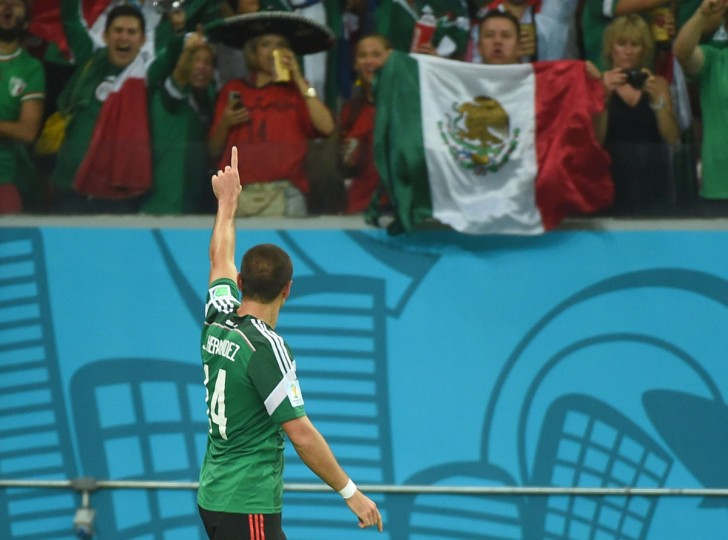 Mexico forward Javier Hernandez celebrates after scoring during a Group A football match between Croatia and Mexico at the Pernambuco Arena in Recife during the 2014 FIFA World Cup on June 23, 2014. (EMMANUEL DUNAND/AFP/Getty Images)