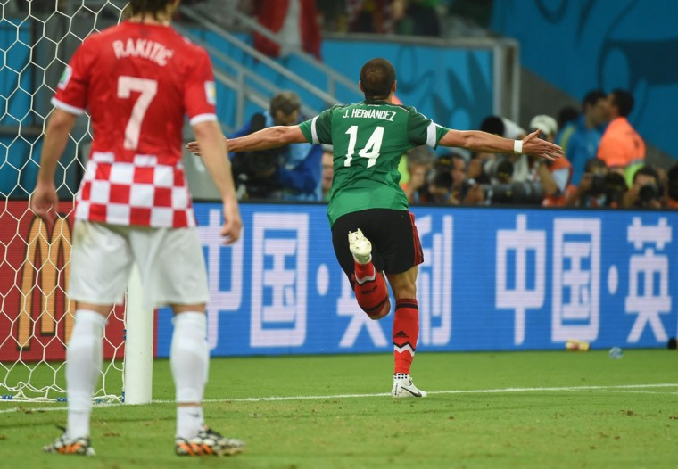 Mexico forward Javier Hernandez (right) celebrates after scoring during a Group A football match at the Pernambuco Arena in Recife during the 2014 FIFA World Cup on June 23, 2014. (EMMANUEL DUNAND/AFP/Getty Images)