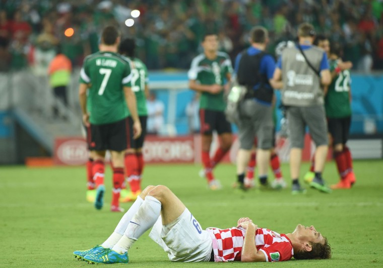 Croatia forward Nikica Jelavic lays on the pitch after a Group A football match between Croatia and Mexico at the Pernambuco Arena in Recife during the 2014 FIFA World Cup on June 23, 2014. (EMMANUEL DUNAND/AFP/Getty Images)