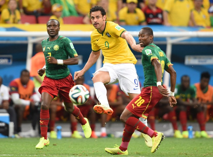 Brazil forward Fred (center) vies with Cameroon midfielder Landry N'Guemo and Cameroon midfielder Enoh Eyong (right) during a Group A football match at the Mane Garrincha National Stadium in Brasilia during the 2014 FIFA World Cup on June 23, 2014. (FRANCOIS XAVIER MARIT/AFP/Getty Images)