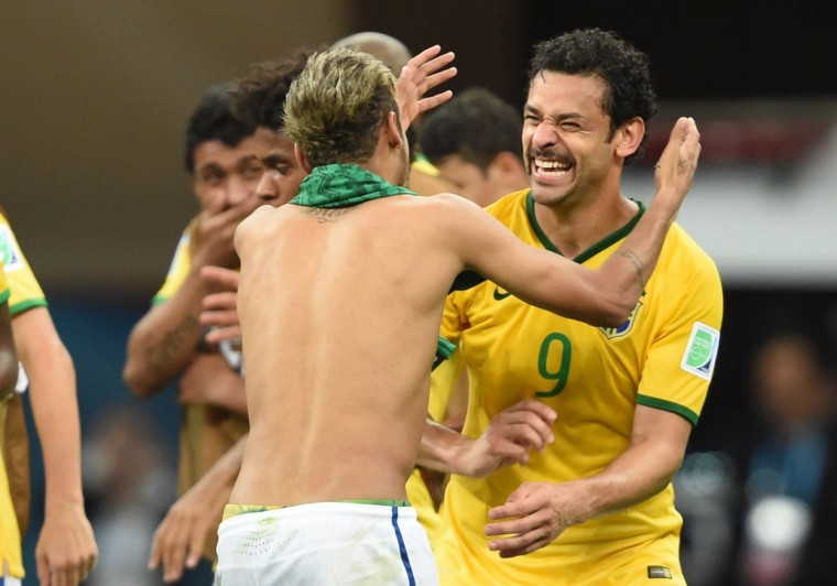 Brazil forward Neymar (left) celebrates with Brazil forward Fred at the end of a Group A football match at the Mane Garrincha National Stadium in Brasilia during the 2014 FIFA World Cup on June 23, 2014. (FRANCOIS XAVIER MARIT/AFP/Getty Images)