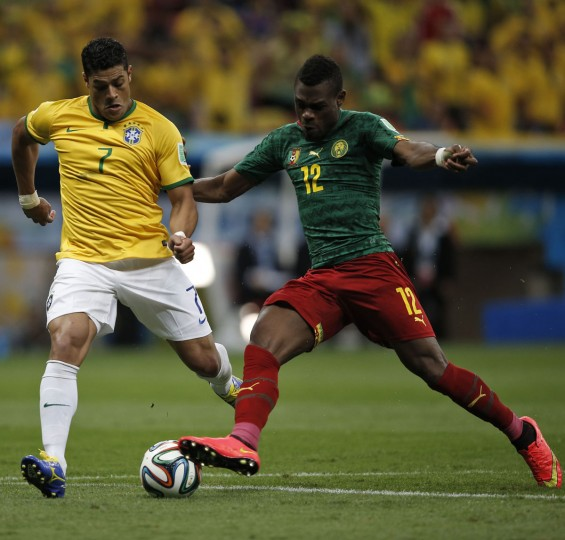 Brazil forward Hulk (left) and Cameroon defender Henri Bedimo vie for the ball during the Group A football match between Cameroon and Brazil at the Mane Garrincha National Stadium in Brasilia during the 2014 FIFA World Cup on June 23, 2014. (ADRIAN DENNIS/AFP/Getty Images)