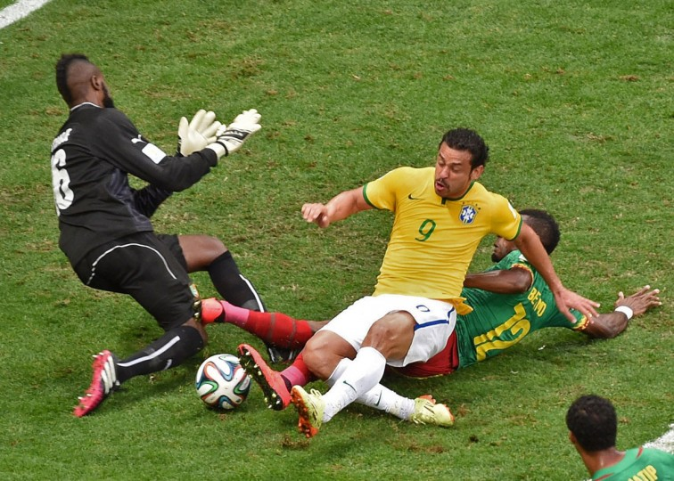 Cameroon goalkeeper Charles Itandje (left), Brazil forward Fred (center) and Cameroon defender Henri Bedimo (right) vie for the ball during a Group A football match at the Mane Garrincha National Stadium in Brasilia during the 2014 FIFA World Cup on June 23, 2014. (EVARISTO SA/AFP/Getty Images)