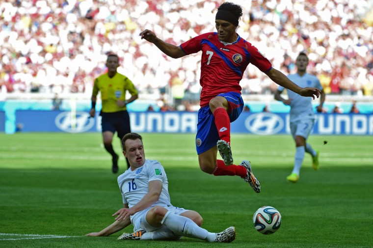 Costa Rica midfielder Cristian Bolanos (right) is challenged by England defender Phil Jones during a Group D match at the Mineirao Stadium in Belo Horizonte during the 2014 FIFA World Cup on June 24, 2014. (RONALDO SCHEMIDT/AFP/Getty Images)