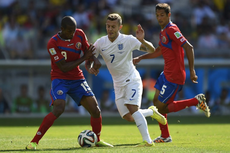 England midfielder Jack Wilshere (center) vies for the ball against Costa Rica midfielder Celso Borges (right) and Costa Rica defender Roy Miller (left) during a Group D match on June 24, 2014. (GUSTAVO ANDRADE/AFP/Getty Images)