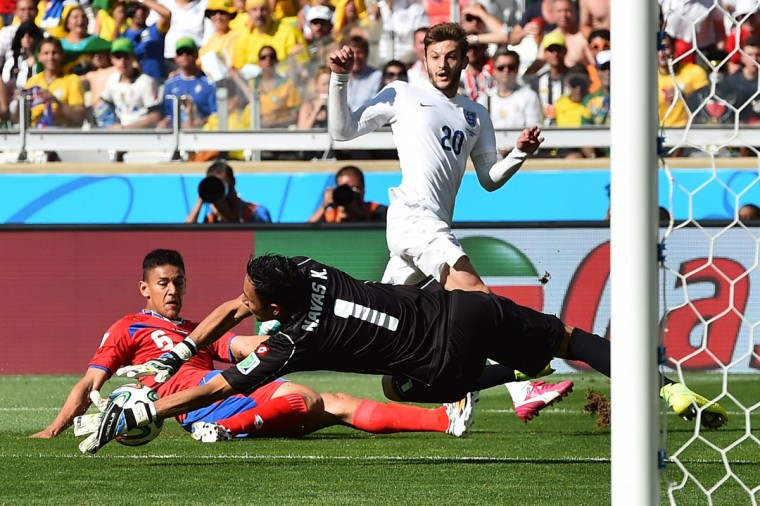 England midfielder Adam Lallana (right) looks on as Costa Rica goalkeeper Keylor Navas (center) makes a save with Costa Rica's defender Oscar Duarte (left) during a Group D football match at The Mineirao Stadium in Belo Horizonte on June 24, 2014,during the 2014 FIFA World Cup . (BEN STANSALL/AFP/Getty Images)