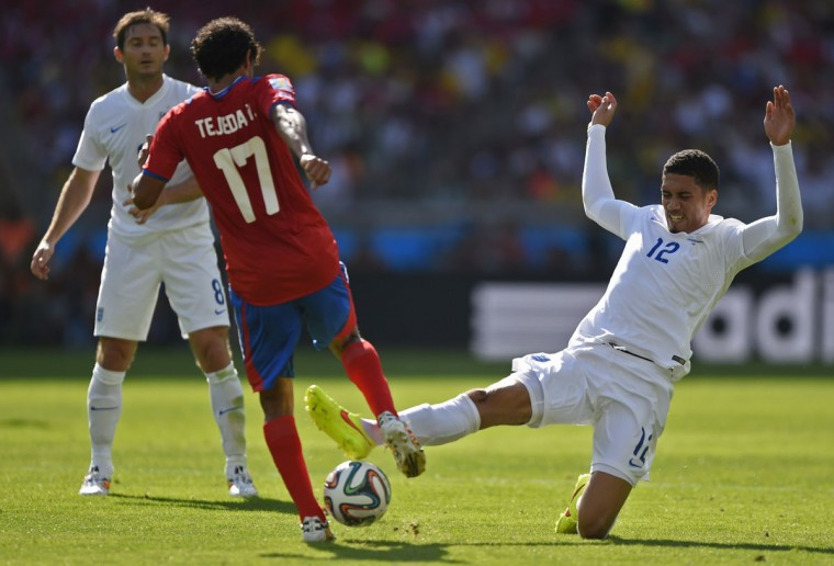 England defender Chris Smalling (right) challenges Costa Rica's midfielder Yeltsin Tejeda (second left) during a Group D match between Costa Rica and England at the Mineirao Stadium in Belo Horizonte during the 2014 FIFA World Cup on June 24, 2014. (GUSTAVO ANDRADE/AFP/Getty Images)