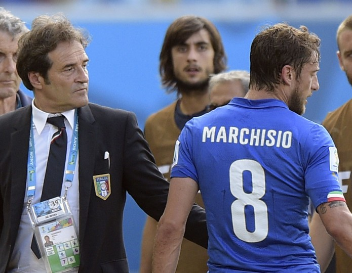 Italy midfielder Claudio Marchisio (right) leaves the pitch after being shown a red card during a Group D football match between Italy and Uruguay at the Dunas Arena in Natal during the 2014 FIFA World Cup on June 24, 2014. (DANIEL GARCIA/AFP/Getty Images)