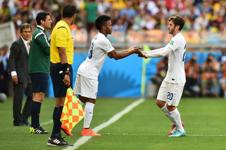 England midfielder Adam Lallana (right) is substituted by midfielder Raheem Sterling (center) during the Group D football match between Costa Rica and England at The Mineirao Stadium in Belo Horizonte on June 24, 2014,during the 2014 FIFA World Cup . (BEN STANSALL/AFP/Getty Images)